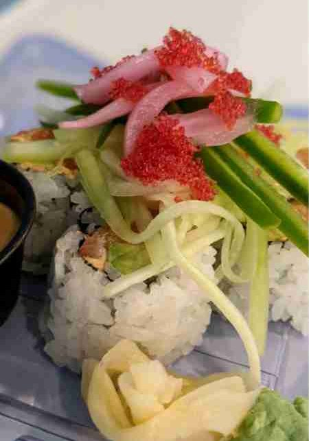 Salmon TNTSalmon, spicy cream cheese, and avocado roll topped with cucumber, jalapeno, pickled red onions, tobiko, and chipotle lime vinaigrette