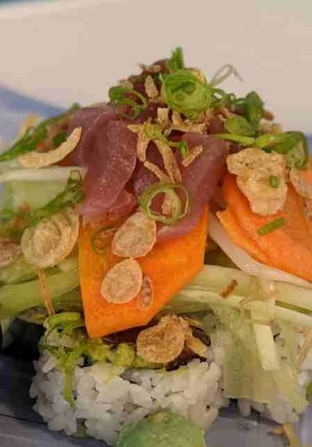 Tuna Poke Yama RollTuna and edamame guacamole roll topped with tuna, cucumber, scallions, pickled carrots, crunchy shallots, bean sprouts, and miso honey ponzu